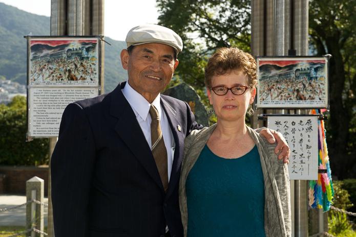 Iinosuke Hayazaki (83), atomic bomb survivor and Olivia Fermi, Nagasaki Peace Park. Photo: © Stephen Imbler 2014.