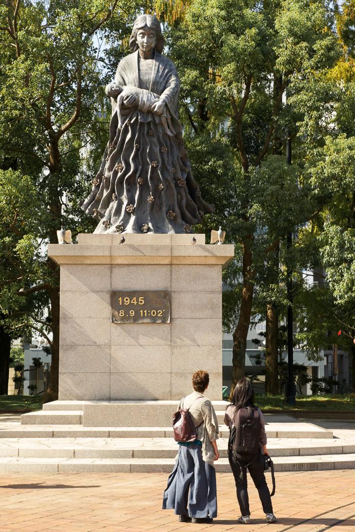 Olivia Fermi and Noriko Nasu Tidbal (l to r) viewing Statue, Nagasaki Peace Park. Photo: © Stephen Imbler 2014.